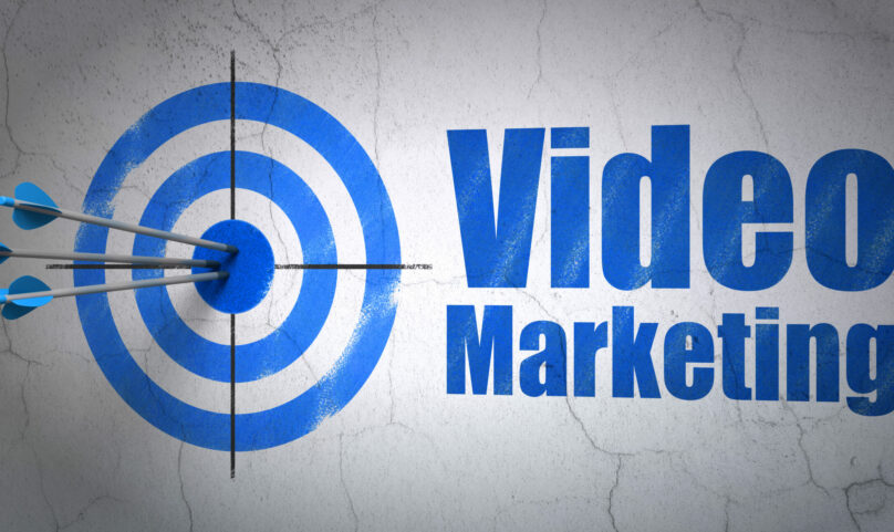 Success business concept: arrows hitting the center of target, Blue Video Marketing on wall background, 3d render